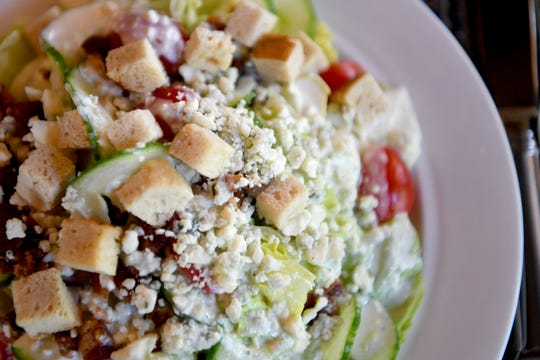 The Cedric's Tavern salad  on the Biltmore Estate is chopped baby iceberg lettuce, grape tomatoes, cucumbers, bacon, pretzel croutons, and blue cheese dressing and crumbles.
