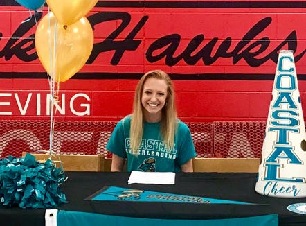 North Buncombe senior standout Clay Davis signed last week to cheer at Coastal Carolina University.