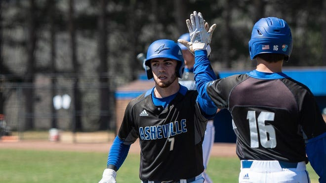 UNC Asheville baseball player Danny Wilson (No. 7) is greeted by teammate Kole Harris (No. 16).
