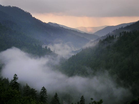 Sunset lights the western sky as fog fills the valley just west of Newfound Gap in the Great Smoky Mountains National Park Sunday, June 19, 2005.