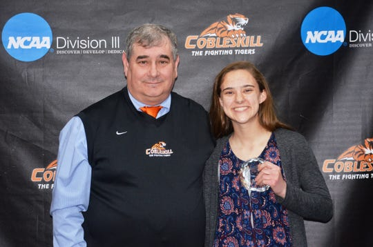 SUNY Cobleskill cross-country coach Mitch Tomaszkiewicz and Seton Catholic Central graduate Natalie Honken pose for a photo. Honken was named the Fighting Tigers' Most Valuable Runner.
