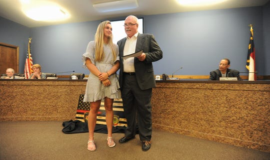 Black Mountain alderman Tim Raines introduces his former player Chesney Gardner before reading a proclamation recognizing the NCHSAA Female Athlete of the Year for 2019.