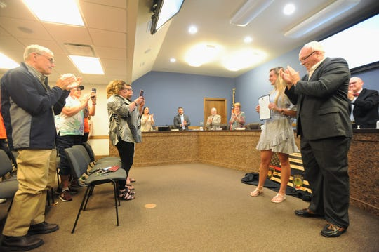 Chesney Gardner receives a standing ovation during the board of aldermen meeting on May 13, when she was recognized by the town for winning the Pat Best Memorial Trophy, giving to the top female high school athlete in the state each year.