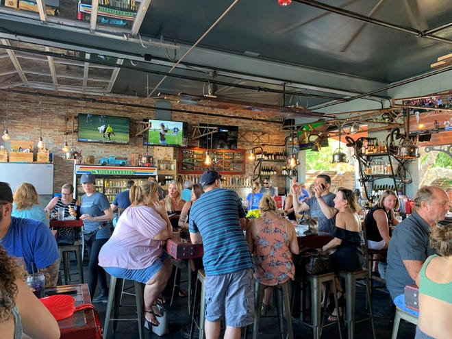 Before the novel coronavirus, the bar at 4th Street Fillin Station in Cocoa Beach stayed packed. Now, owner Daniel Todd said only 25 customers will be allowed inside.