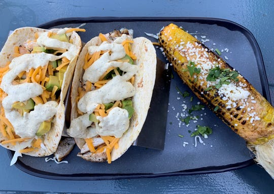 Chicken Tacos and elote at 4th Street Fillin Station in Cocoa Beach.