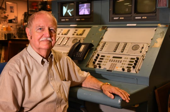 Retired NASA engineer Charlie Mars sits at a launch console that was used for the space shuttle and Apollo launches.