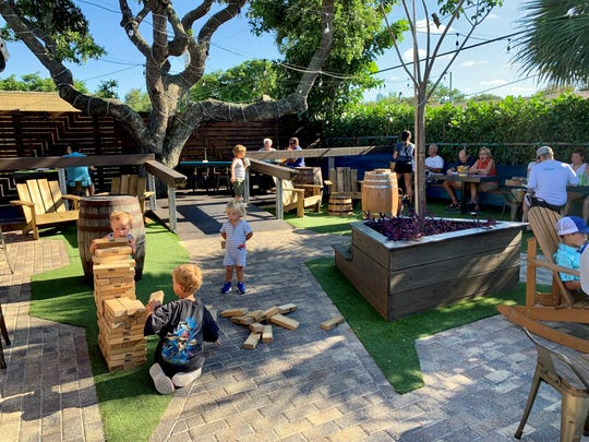 The back yard at 4th Street Fillin Station features a kid-friendly Giant Jenga game.