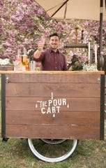 David Cornwell of Sicklerville, owner of The Pour Cart, displays a champagne raspberry lemonade mimosa.  David Cornwell and his father, Dave Cornwell of Clementon, converted a vintage bicycle into a liquid catering company.