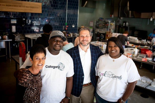 Cynthia Oxley of the Cincinnati USA Regional Chamber,  from left, Jeffery Harris of Category 5, Brendon Cull of the chamber  and Candice Holloway of Soul Secrets  at Findlay Kitchen in Over-the-Rhine on Monday, May 20, 2019.
