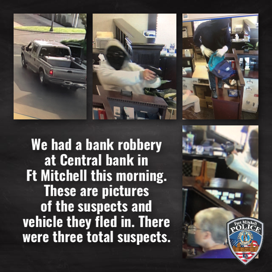 Fort Mitchell Police Department released a set of images on social media showing men wearing masks, at least one with a finger on a gun's trigger, May 16, 2019, inside Central Bank during an armed robbery.