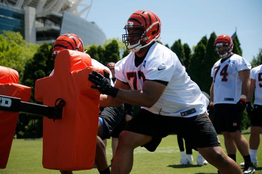 Cincinnati Bengals offensive tackle Cordy Glenn (77) works on a drill during practice in the first day of OTAs at the Paul Brown Stadium practice field in downtown Cincinnati on Monday, May 20, 2019.