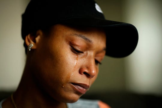 Whitney Burns, 29, of Northside, weeps while talking about her late sister's drive to complete her high school education. Burns' sister, Chae'Von Bowman, 31, who died April 29, will be remembered Wednesday night at the graduation ceremony for Dohn Community High School's 22 Plus Program.