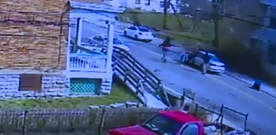 Screen capture of security video that shows the fatal shooting of Jamie Urton on March 24, 2017. Prosecutors say Deonte Baber is the man whose right arm is extended, firing multiple gunshots into the car.
