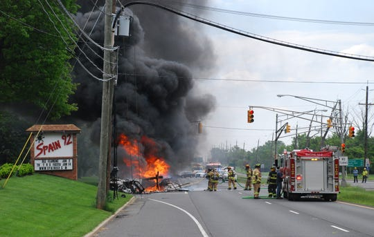 A truck fire and downed utility wires closed Route 202 for hours on Monday.