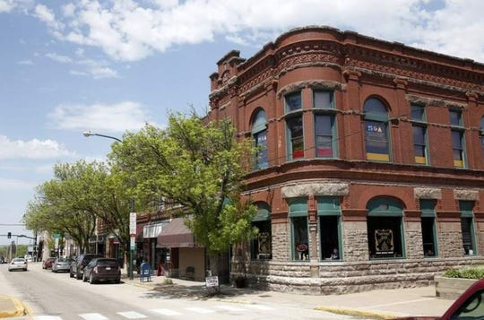 Originally the First National Bank, 1090 Seventh Ave. in Marion now houses the Iowa Magic Shop on the ground floor and Martin Gardner Architecture on the second.
