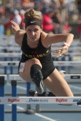 Carlisle senior Jocelyn Haack runs the anchor leg in the 4x100-meter shuttle hurdle preliminary. The Widlcats finished 11th in qualifying. The state high school track meet's first day of competition was held May 16 at Drake Stadium in Des Moines.