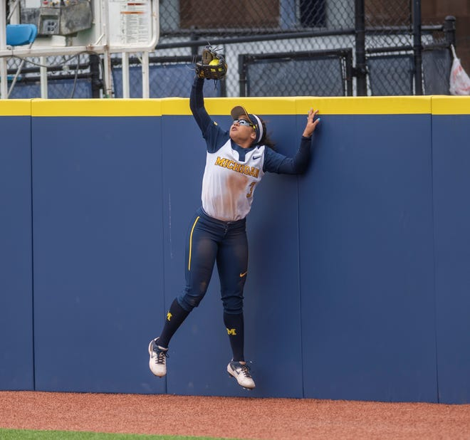 Michigan left fielder Lexie Blair makes a catch against the wall during the NCAA regional game against James Madison on Monday, may 20, 2019, in Ann Arbor.