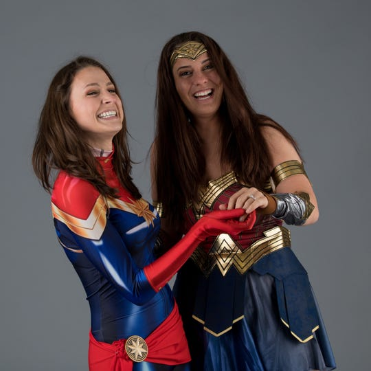 "Ashley Vansickle (Captain Marvel, left), 26, asked Deanna Mascia (Wonder Woman), 25, to marry her at Motor City Comic Con on May 18, 2019. This portrait was taken by photographer Susan Onysko. Onysko is in the process of attending comic con-style events in every state as she works on a book project that she's calling ""Cosplay 50: The United States of Cosplay."""