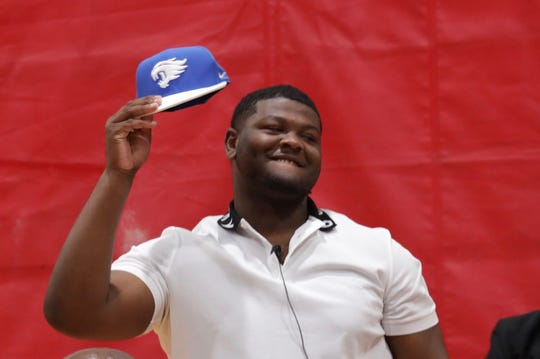 Oak Park senior Justin Rogers announces his commitment to Kentucky during a ceremony at the school in May.