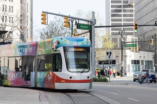 A QLINE street car goes around Campus Martius Park in downtown Detroit, Wednesday, May 8, 2019.