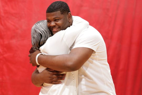 Oak Park senior Justin Rogers hugs his grandma Brenda Latimer before he announces his commitment to Kentucky during a ceremony at the school Monday, May 20, 2019.