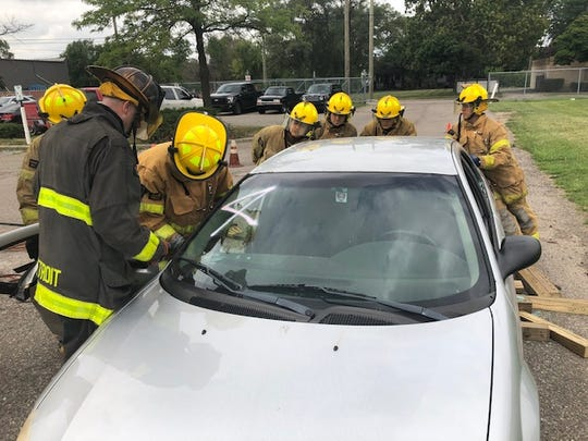 Detroit firefighters participating in a 2018 extrication class. Chief of Training, Alfie Green, said new firefighters undergo training to respond to incidents that may involve many different types of vehicles, including electric cars.