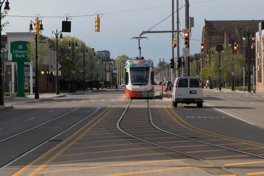A QLINE streetcar waits near the Grand Boulevard station in Detroit due to a delay, Wednesday, May 8, 2019.