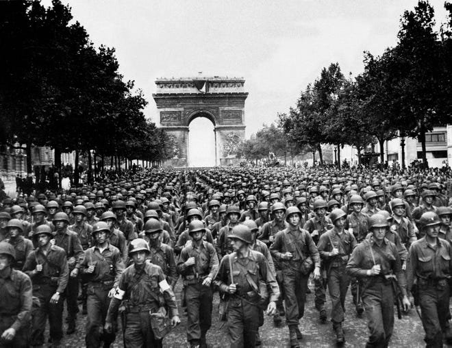 Eisenhower did not consider Paris a vital military objective and chose not to commit troops to the capital after D-Day. But after the French Resistance staged an uprising on Aug. 9, 1944, he relented, and American and Free French troops made a peaceful entrance on Aug. 25. Here, four days later, soldiers of Pennsylvania's 28th Infantry Division march along the Champs-Elysees, with the Arc de Triomphe in the background.