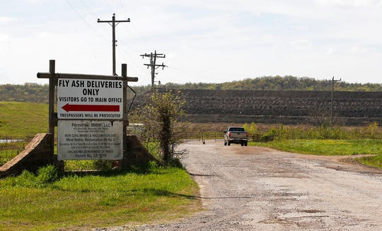 This April 8, 2019, photo, shows a coal-waste dump site in Bokoshe, Okla. Residents of Bokoshe have been worried for years about coal-ash contamination. Now the Environmental Protection Agency has approved Oklahoma to be the first state to take over enforcement on coal-ash sites.