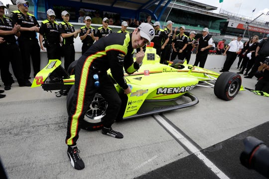 Simon Pagenaud celebrates after winning the pole for the Indianapolis 500.