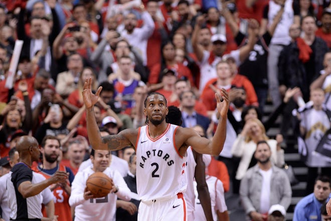 Toronto Raptors forward Kawhi Leonard reacts following Sunday's win.