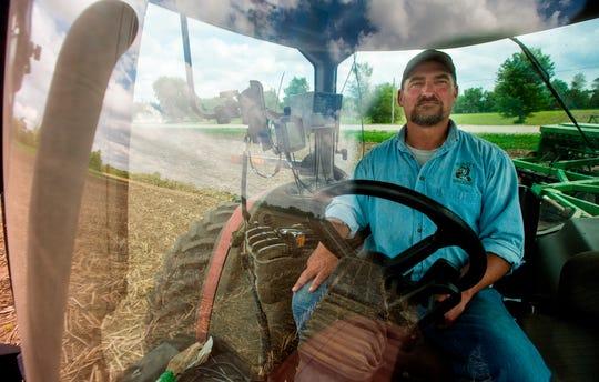 "Farmer Tim Bardole plants a field near Perry, Iowa. ""He does really seem to be fighting for us,"" Bardole says of Trump."