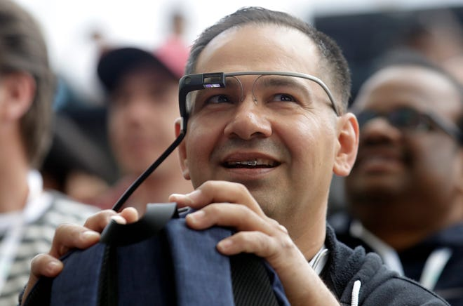 Developer Jesus Suarez wears Google Glass glasses as he waits for the keynote address of the Google I/O conference in Mountain View, Calif., Tuesday, May 7, 2019. Alphabet, along with Microsoft Corp. and a slew of startups, are bringing so-called wearables back as part of a push to make warehouses and manufacturing more efficient with the help of technology.