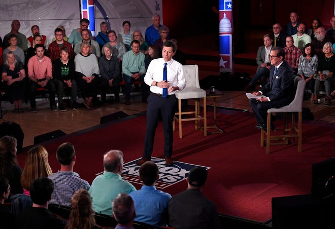 Democratic presidential candidate South Bend, Ind., Mayor Pete Buttigieg, center, answers a question during a FOX News Channel town hall moderated by Chris Wallace Sunday, May 19, 2019, in Claremont, N.H.