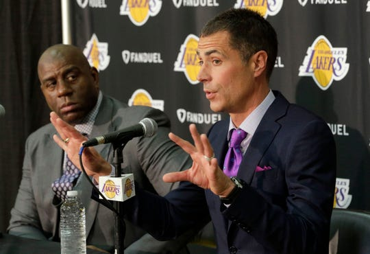 Magic Johnson, left, listens as Rob Pelinka talks during a news conference introducing him as the new general manager in 2017.