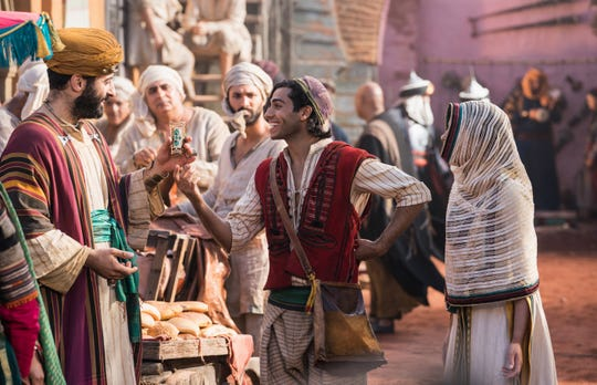 "Mena Massoud is Aladdin and Naomi Scott is Jasmine in Disney's live-action ""Aladdin."""