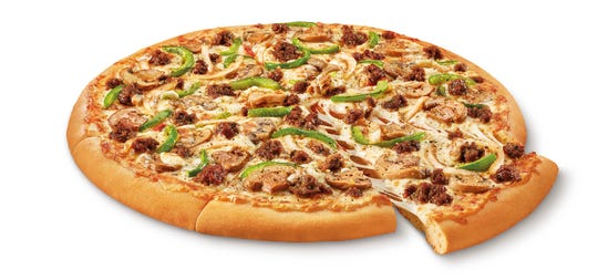 The Impossible Supreme pizza. Plant-based burger maker Impossible Foods is debuting its second product - meatless sausage crumbles - on Little Caesars pizza.