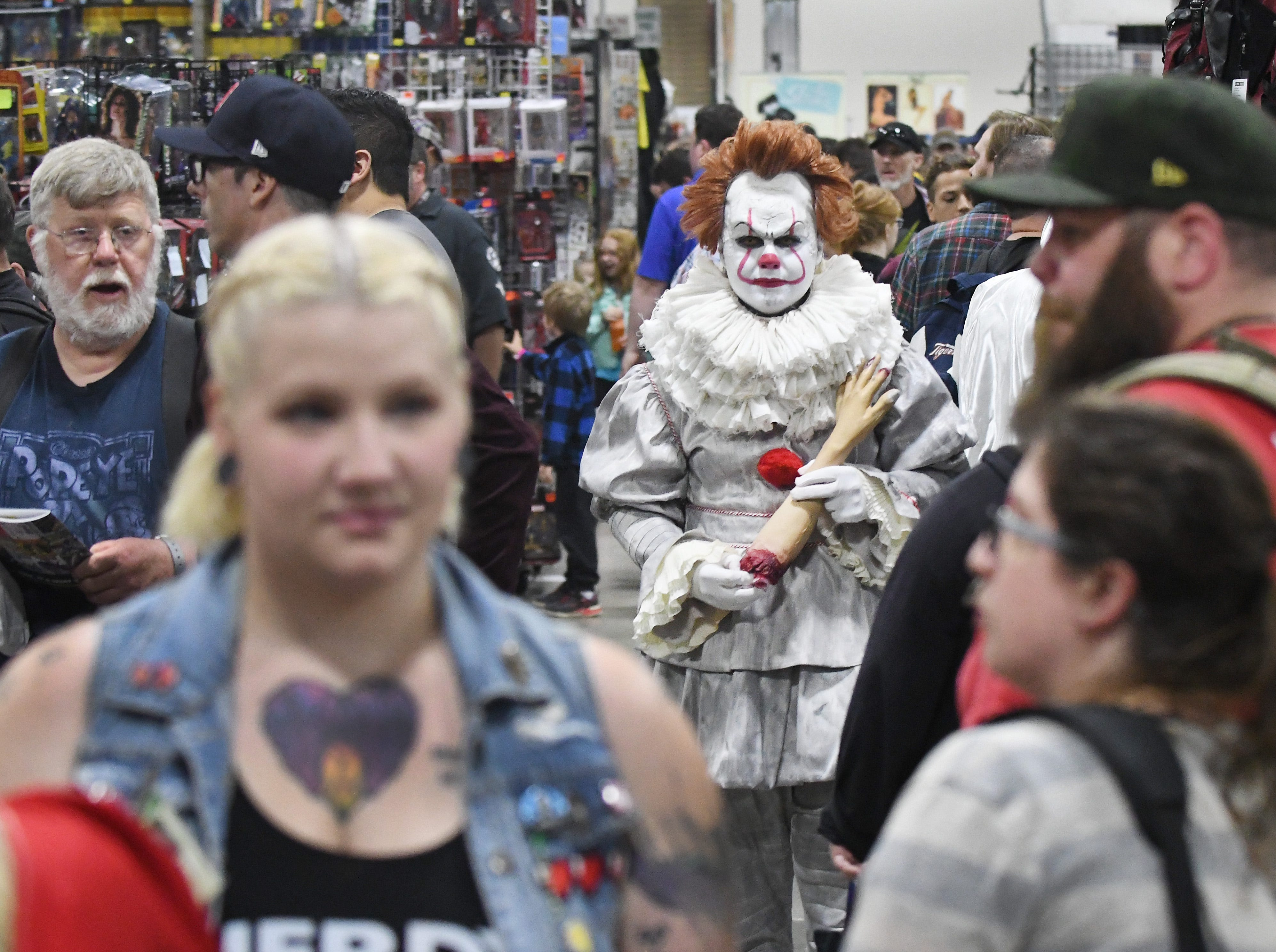 Zack Stone is terrifying as he walks down the aisles at Motor City Comic Con in Novi as Pennywise the Dancing Clown from Stephen King's 'It' book and film on May 17, 2019.