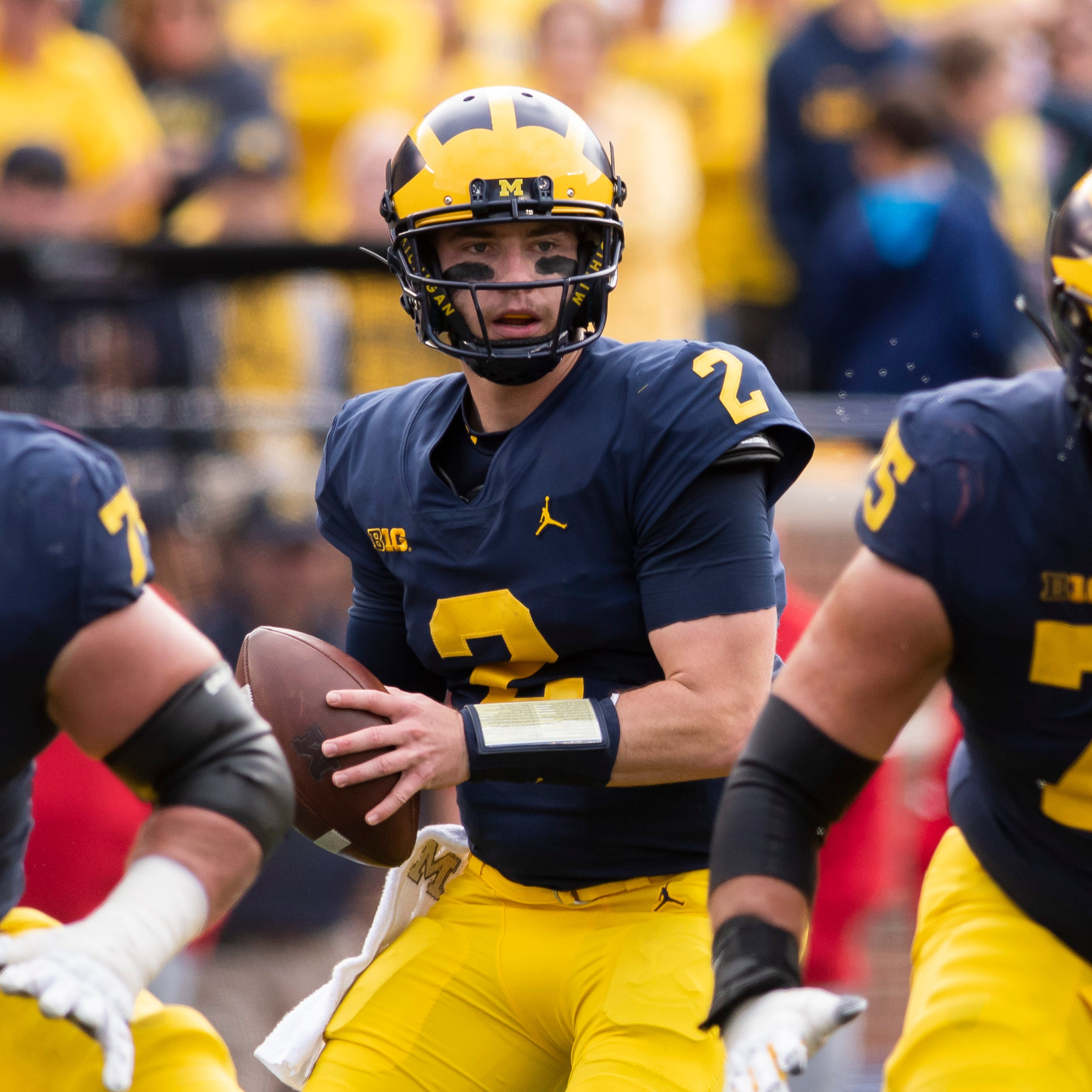 Predictions: Michigan makes CFP; Willekes, Bachie, Hill first-team All-Americans