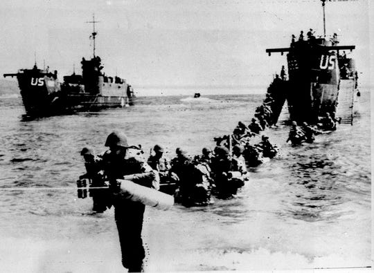 American and allied troops wade through the water from an LST (Landing Ship, Tank) on an unidentified beach, east of Toulon, southern French Riviera, as part of Operation Dragoon, on Aug. 16, 1944. Operation Dragoon landings came 70 days after the D-Day landings in Normandy and were smaller in scale. In all, an estimated 300,000 Allied soldiers stormed France's Mediterranean shores from Toulon to Cannes.
