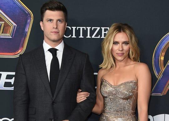 Colin Jost, left, and Scarlett Johansson.