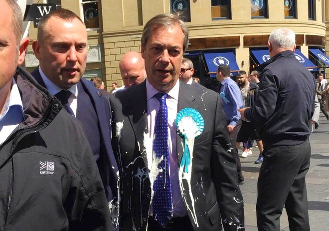 Britain's Nigel Farage after being hit with a milkshake during a campaign walkabout in Newcastle, England, Monday May 20, 2019.