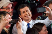 Democratic presidential candidate Pete Buttigieg takes a selfie with audience members after a Fox News Channel town hall.