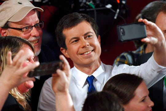 Democratic presidential candidate South Bend, Ind., Mayor Pete Buttigieg takes a selfie with audience members after a FOX News Channel town hall.