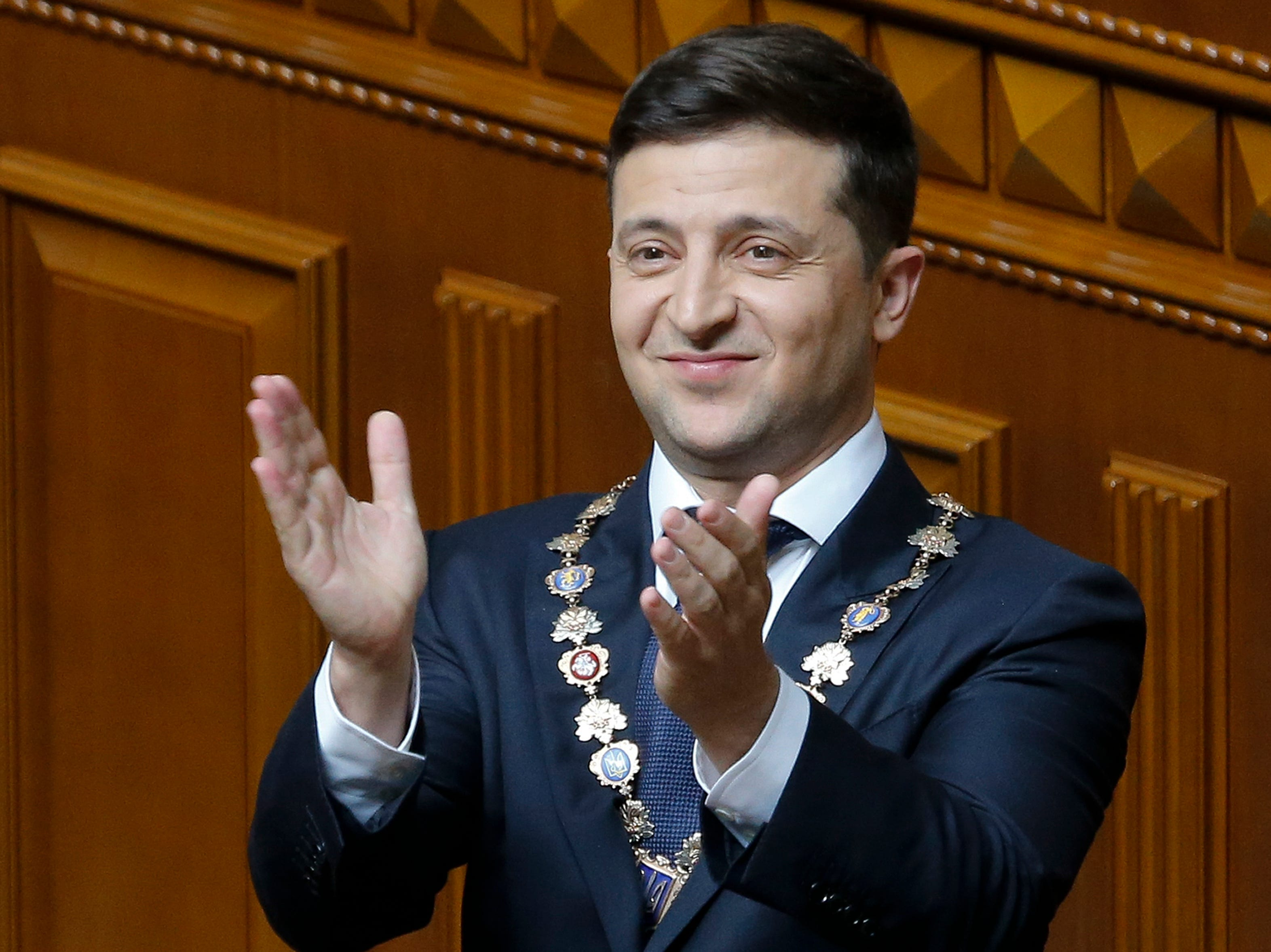 Volodymyr Zelenskiy gestures during his inauguration ceremony in Kiev, Ukraine, Monday, May 20, 2019. The television star was sworn in as Ukraine's next president after he beat the incumbent at the polls last month. The ceremony was held at the Ukrainian parliament in Kiev on Monday morning.