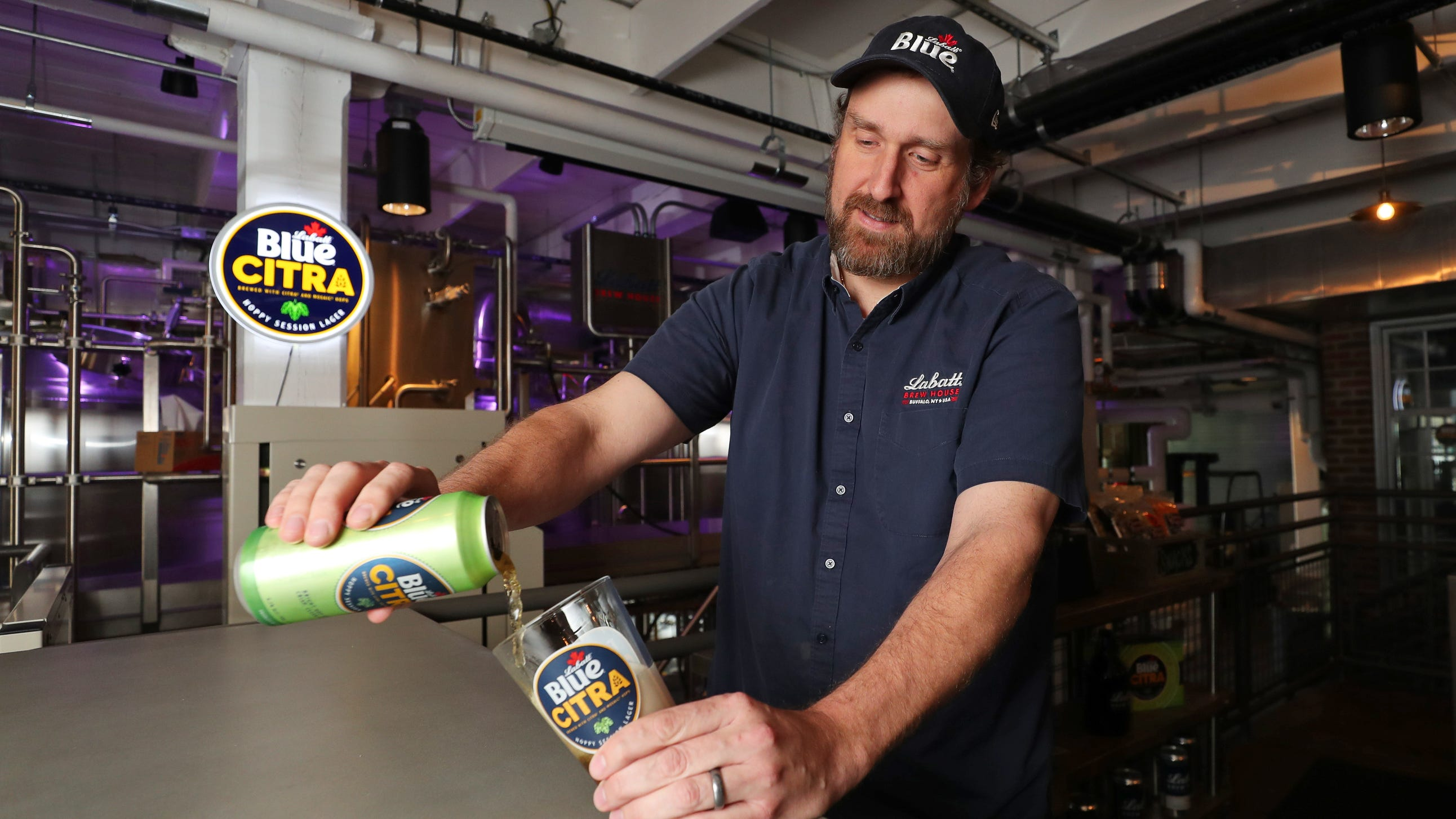 Labatt USA brewmaster Ryan Brady pours a Labatt Blue Citra at The Labatt Brew House in Buffalo, NY. Photo by Bill Wippert/PicSix Creative May 20, 2019