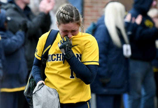 Michigan's Alex Sobczak fights back tears as she walks off the field following the Wolverines' 2-1 loss.