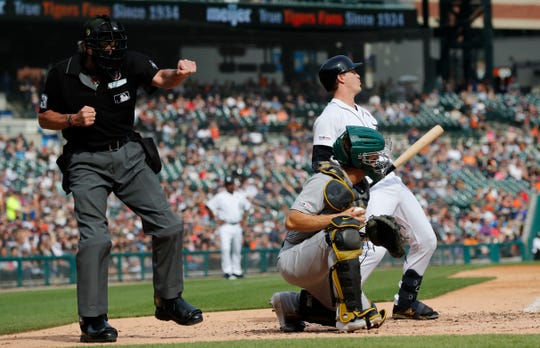 Home plate umpire Mike Winters calls out Tigers designated hitter Brandon Dixon on strikes during the fourth inning of a game against the Oakland A's on Saturday in Detroit.