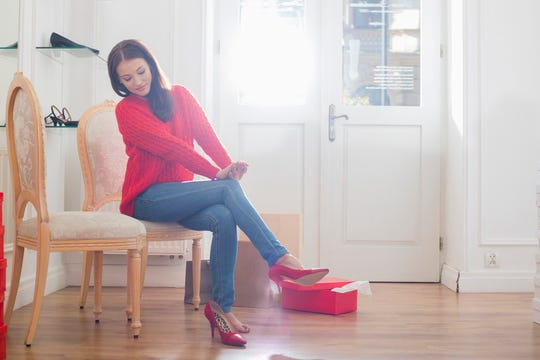 Wait until the last minute to put on your high heels to prolong the life of your hardwood floors.