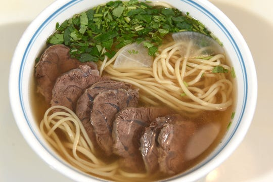 Lanzhou beef La-Mian made with traditional beef noodle soup with radish and cilantro at Jiang Nan Noodle House in Farmington Hills.